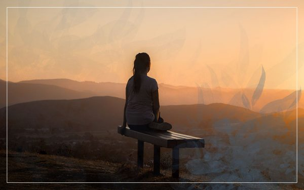 Girl on a bench in the sunset