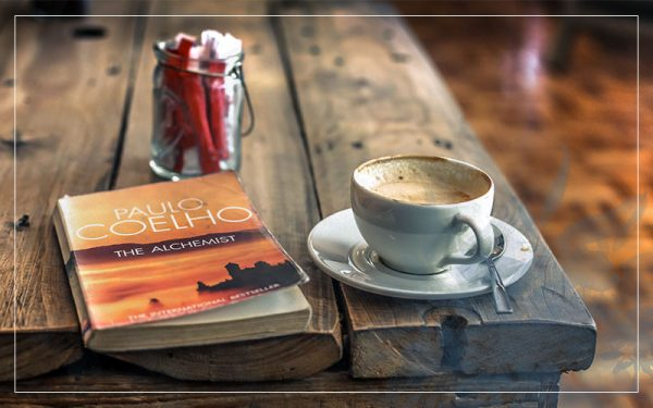 Coffee and book the alchemist